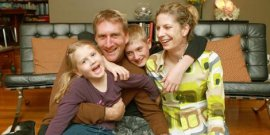 Dolla Merrillees with daughter Shakar, husband Simm and stepson, Jordan.